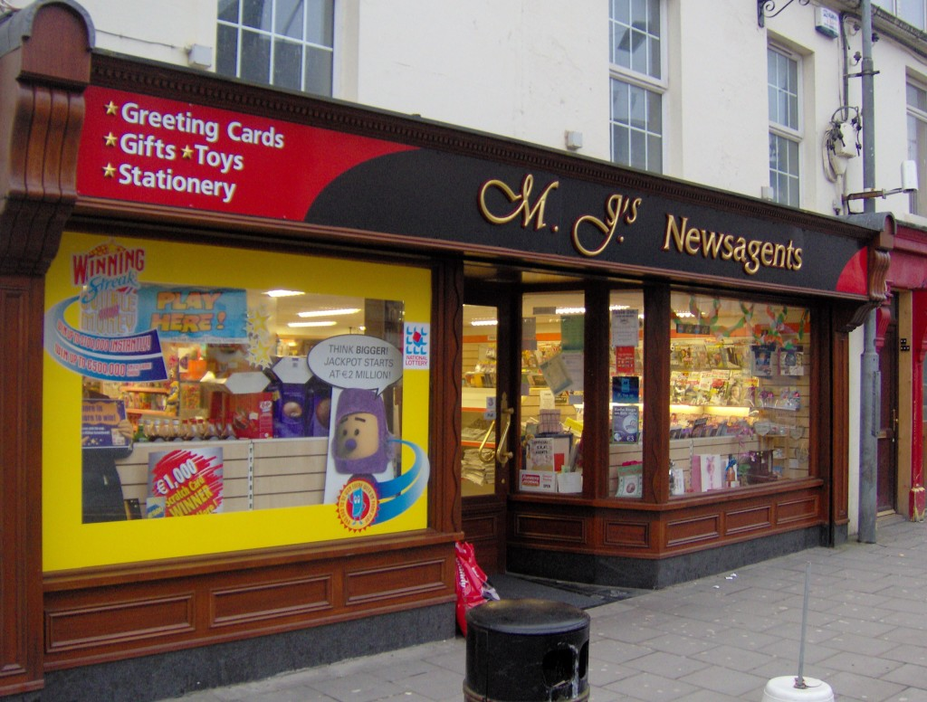 Image of a Traditional Wooden Shopfront Sign - MJ's Newsagents Cootehill Cavan