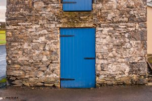 Mock Wooden door on an old stone building - Tricoya
