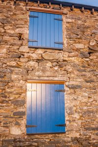 Wooden Shutter on a stone building - Tricoya - Closeup