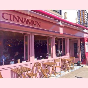 Image of a cafe shop front in Ireland with open bi-folding windows - Cinnamon Monkstown Dublin