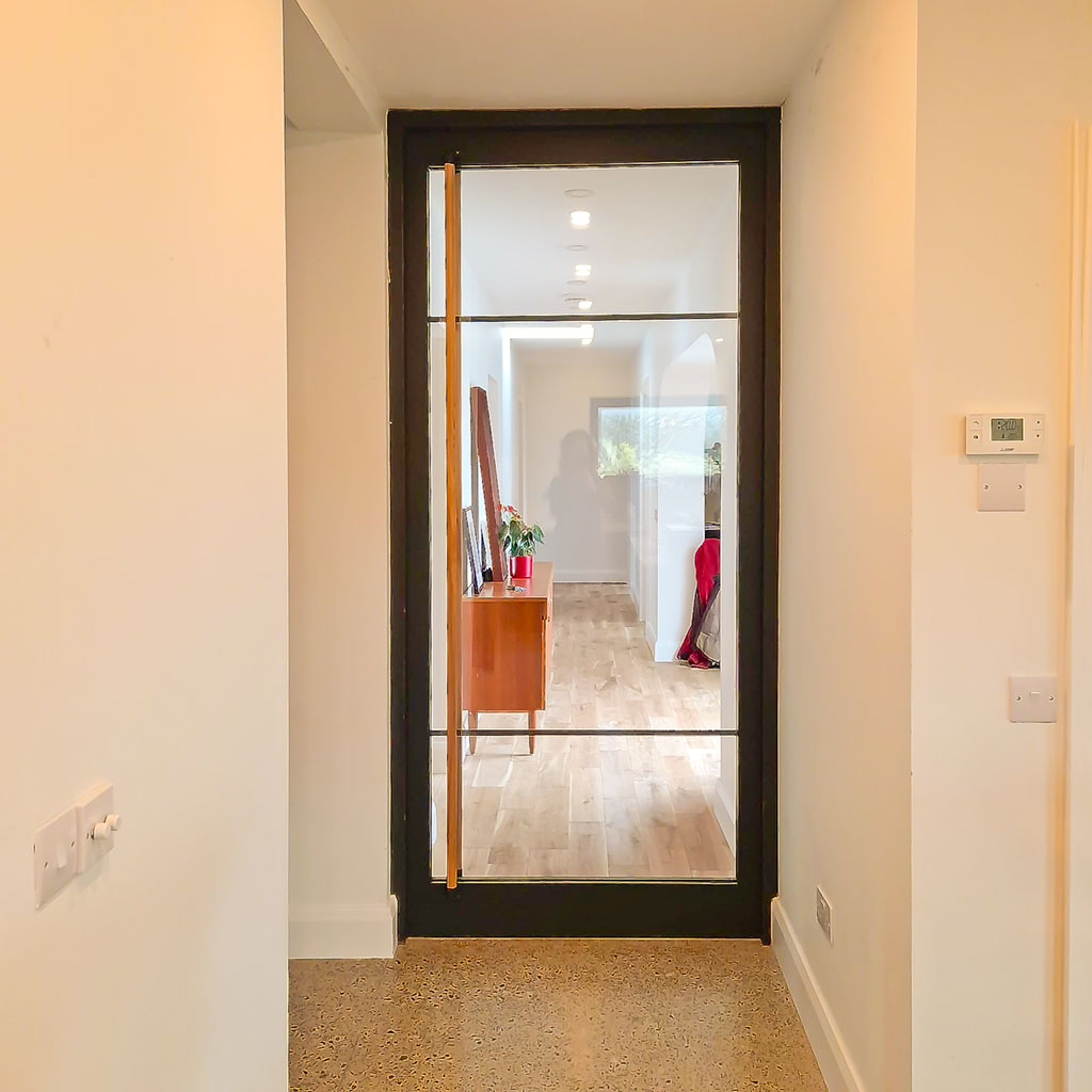 Crittal Style Glass and Timber Door with full length Ash Handles for a modern home